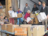 Kolpingfamilie mit gesammelten Paketen